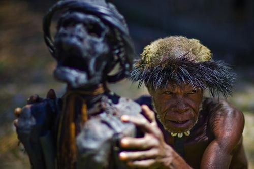 A Dani man with a mummified relative indoglobaltours.com