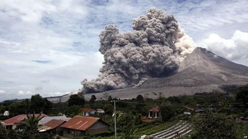 Mount Sinabung spew volcanic ash seen from the village of Tiga Serangkai, North Sumatra, April 1, 2015. AP Photo / Binsar Bakkara